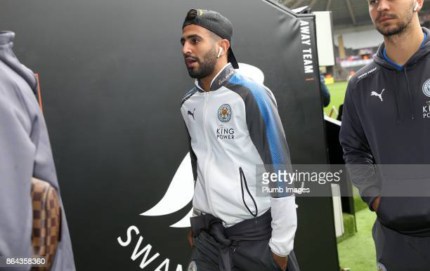 Riyad Mahrez of Leicester City arrives at Liberty Stadium ahead of the Premier League match between Swansea City and Leicester City at Liberty...