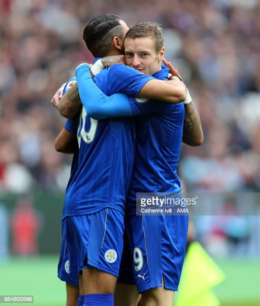 Riyad Mahrez of Leicester City celebrates after scoring to make it 01 with Jamie Vardy of Leicester City during the Premier League match between West...