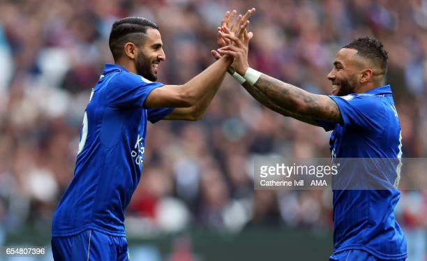 Riyad Mahrez of Leicester City celebrates after scoring to make it 01 with Danny Simpson of Leicester City during the Premier League match between...
