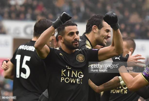 Riyad Mahrez of Leicester City celebrates after Shinji Okazaki of Leicester City scores to make it 02 during the Premier League match between Swansea...
