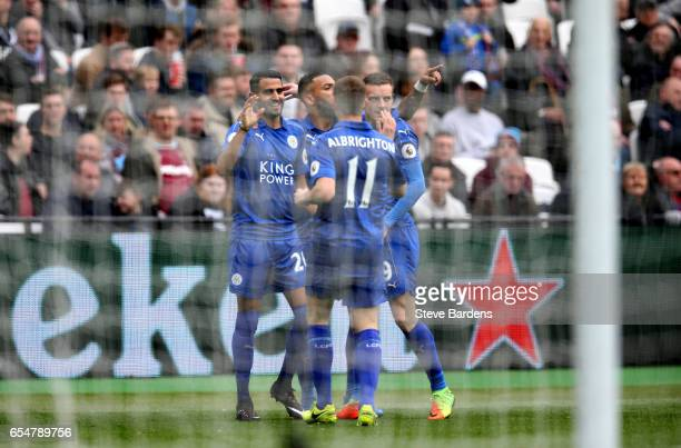 Riyad Mahrez of Leicester City celebrates scoring his sides first goal with his Leicester City team mates during the Premier League match between...