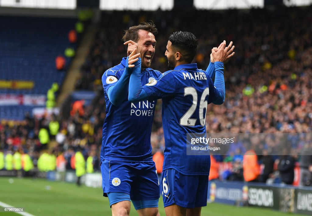 Riyad Mahrez of Leicester City celebrates scoring his sides second goal with Christian Fuchs of Leicester City during the Premier League match between Leicester City and Watford at The King Power Stadium on May 6, 2017 in Leicester, England.