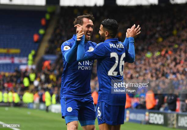 Riyad Mahrez of Leicester City celebrates scoring his sides second goal with Christian Fuchs of Leicester City during the Premier League match...