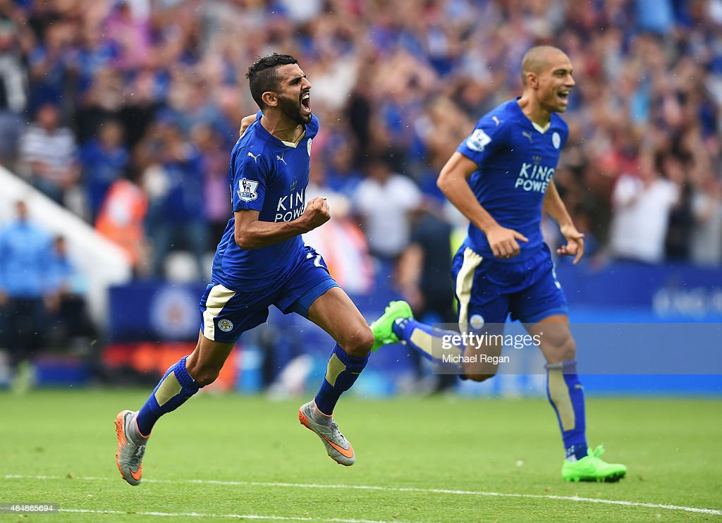 Riyad Mahrez (L) of Leicester City celebrates scoring his team's first goal during the Barclays Premier League match between Leicester City and Tottenham Hotspur at The King Power Stadium on August 22, 2015 in Leicester, England.