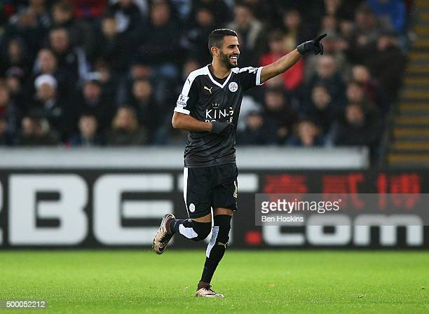 Riyad Mahrez of Leicester City celebrates scoring his team's first goal during the Barclays Premier League match between Swansea City and Leicester...