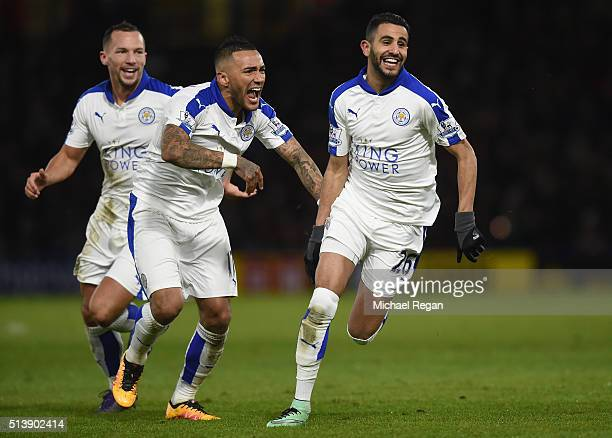 Riyad Mahrez of Leicester City celebrates scoring his team's first goal with his team mates Danny Drinkwater and Danny Simpson during the Barclays...
