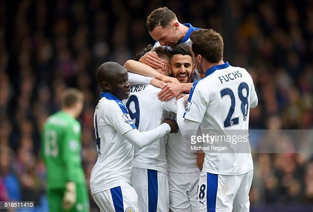 Riyad Mahrez of Leicester City celebrates scoring his team's first goal with his team mates during the Barclays Premier League match between Crystal...