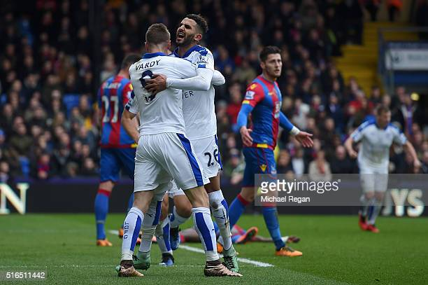 Riyad Mahrez of Leicester City celebrates scoring his team's first goal with his team mate Jamie Vardy during the Barclays Premier League match...