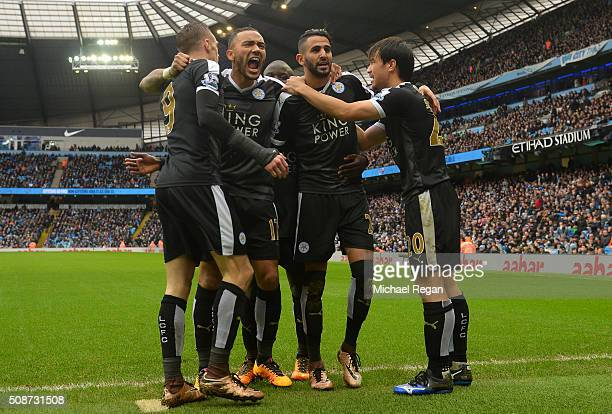 Riyad Mahrez of Leicester City celebrates scoring his team's second goal with his team mates Shinji Okazaki Danny Simpson and Jamie Vardy during the...