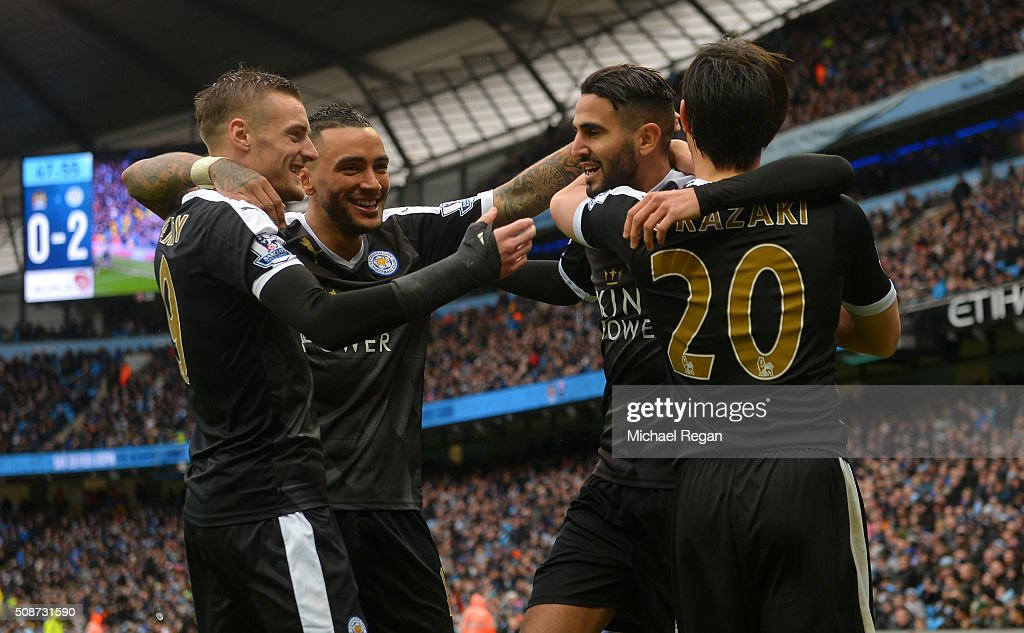 <a gi-track='captionPersonalityLinkClicked' href=/galleries/search?phrase=Riyad+Mahrez&family=editorial&specificpeople=9166027 ng-click='$event.stopPropagation()'>Riyad Mahrez</a> (2nd R) of Leicester City celebrates scoring his team's second goal with his team mates <a gi-track='captionPersonalityLinkClicked' href=/galleries/search?phrase=Shinji+Okazaki&family=editorial&specificpeople=4320771 ng-click='$event.stopPropagation()'>Shinji Okazaki</a> (1st R), <a gi-track='captionPersonalityLinkClicked' href=/galleries/search?phrase=Danny+Simpson&family=editorial&specificpeople=803074 ng-click='$event.stopPropagation()'>Danny Simpson</a> (2nd L) and <a gi-track='captionPersonalityLinkClicked' href=/galleries/search?phrase=Jamie+Vardy&family=editorial&specificpeople=8695606 ng-click='$event.stopPropagation()'>Jamie Vardy</a> (1st L) during the Barclays Premier League match between Manchester City and Leicester City at the Etihad Stadium on February 6, 2016 in Manchester, England.