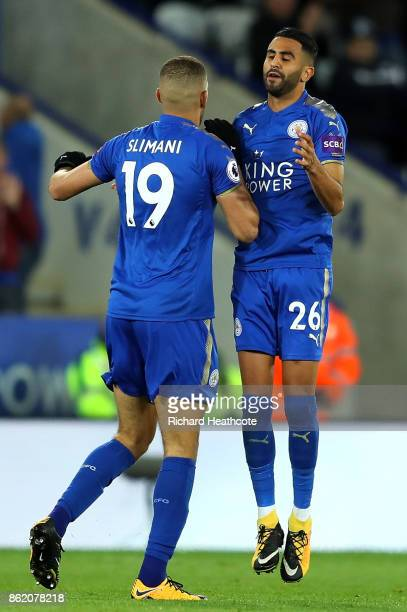 Riyad Mahrez of Leicester City celebrates scoring the first Leicester goal with Islam Slimani of Leicester City during the Premier League match...