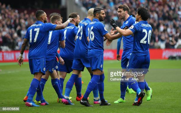 Riyad Mahrez of Leicester City celebrates scoring with his team mates during the Premier League match between West Ham United and Leicester City at...