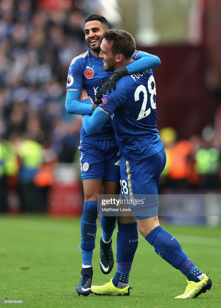 Riyad Mahrez of Leicester City celebrates with Christian Fuchs of Leicester City after scoring his sides second goal during the Premier League match between Stoke City and Leicester City at Bet365 Stadium on November 4, 2017 in Stoke on Trent, England.