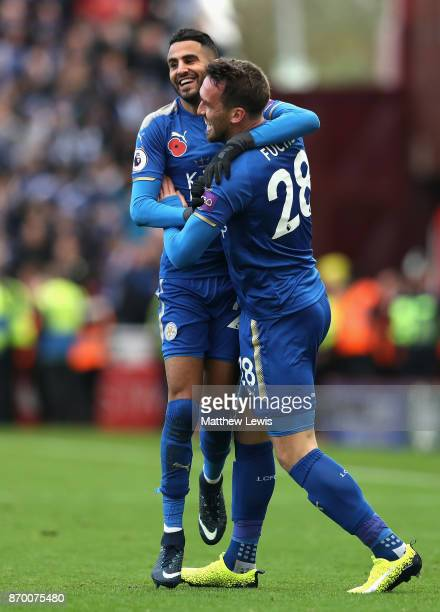 Riyad Mahrez of Leicester City celebrates with Christian Fuchs of Leicester City after scoring his sides second goal during the Premier League match...