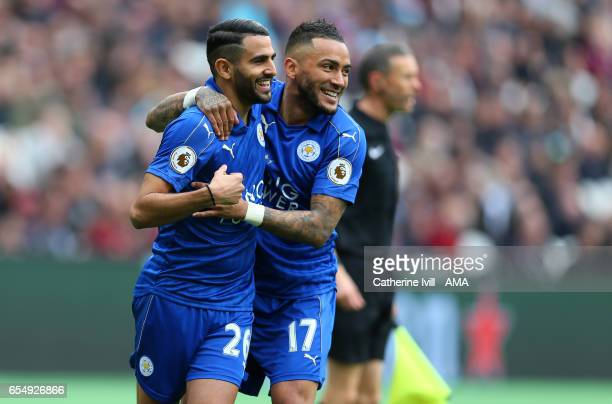 Riyad Mahrez of Leicester City celebrates with Danny Simpson of Leicester City during the Premier League match between West Ham United and Leicester...