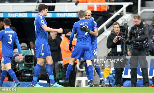 Riyad Mahrez of Leicester City celebrates with Jamie Vardy and Harry Maguire of Leicester City after scoring to make it 11 during the Premier League...