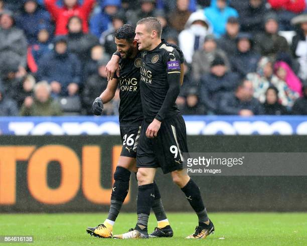 Riyad Mahrez of Leicester City celebrates with Jamie Vardy of Leicester after his cross is put into their own net by Federico Fernandez of Swansea...