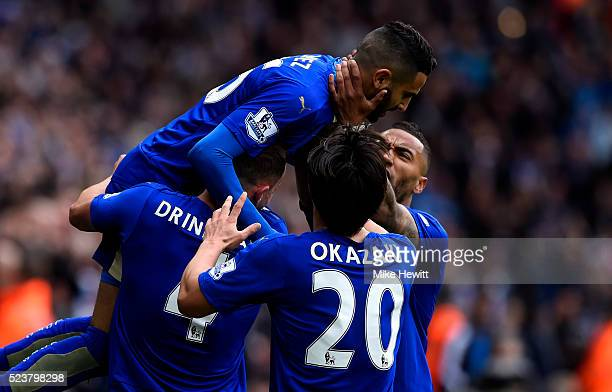 Riyad Mahrez of Leicester City celebrates with team mates as he scores their first goal during the Barclays Premier League match between Leicester...