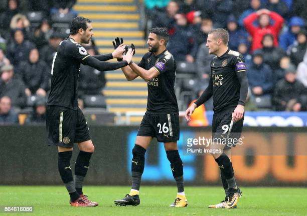 Riyad Mahrez of Leicester City celebrates with Vicente Iborra and Jamie Vardy of Leicester after his cross is put into their own net by Federico...