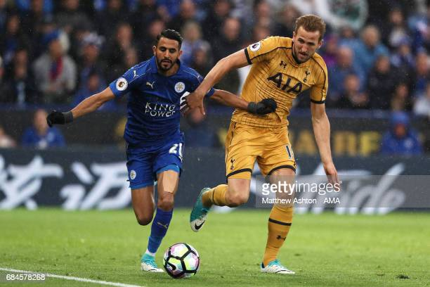 Riyad Mahrez of Leicester City competes with Harry Kane of Tottenham Hotspur during the Premier League match between Leicester City and Tottenham...