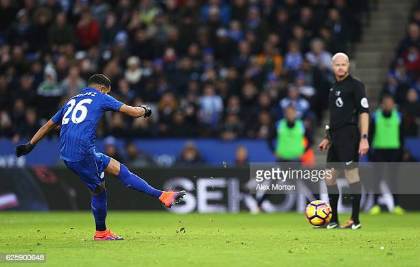Riyad Mahrez of Leicester City converts the penalty to score his team's first goal during the Premier League match between Leicester City and...