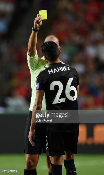 Riyad Mahrez of Leicester City gets a yellow card during the Premier League Asia Trophy match between Liverpool FC and Leicester City FC at the Hong...