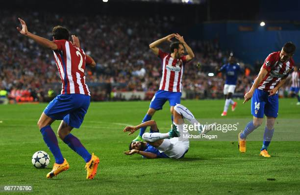 Riyad Mahrez of Leicester City goes to ground after a challenge by Gabi of Atletico Madrid in the penalty area during the UEFA Champions League...