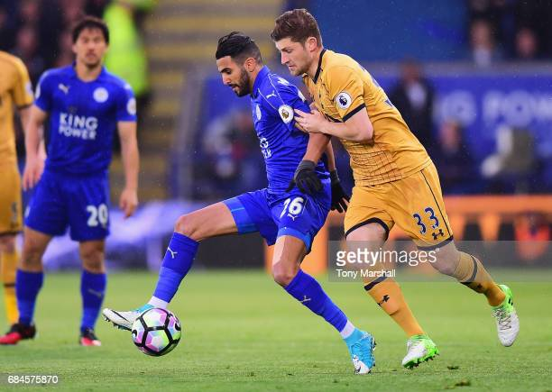 Riyad Mahrez of Leicester City holds off Ben Davies of Tottenham Hotspur during the Premier League match between Leicester City and Tottenham Hotspur...