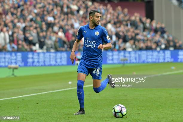 Riyad Mahrez of Leicester City in action during the Premier League match between West Ham and Leicester City at London Stadium on March 18 2017 in...