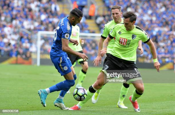 Riyad Mahrez of Leicester City in action with Charlie Daniels of Bournemouth during the Premier League match between Leicester City and Bournemouth...