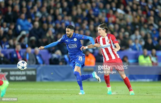 Riyad Mahrez of Leicester City in action with Filipe Luis of Atletico Madrid during the UEFA Champions League Quarter Final Second Leg match between...