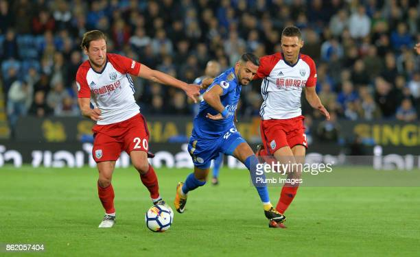 Riyad Mahrez of Leicester City in action with Kieran Gibbs and Grzegorz Krychowiak of West Bromwich Albion during the Premier League match between...