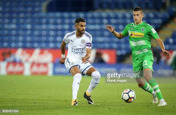 Riyad Mahrez of Leicester City in action with Laszio Benes of Borussia Monchengladbach during the Leicester City v Borussia Monchengladbach Preseason...