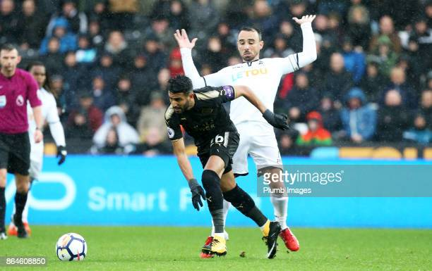 Riyad Mahrez of Leicester City in action with Leon Britton of Swansea City during the Premier League match between Swansea City and Leicester City at...