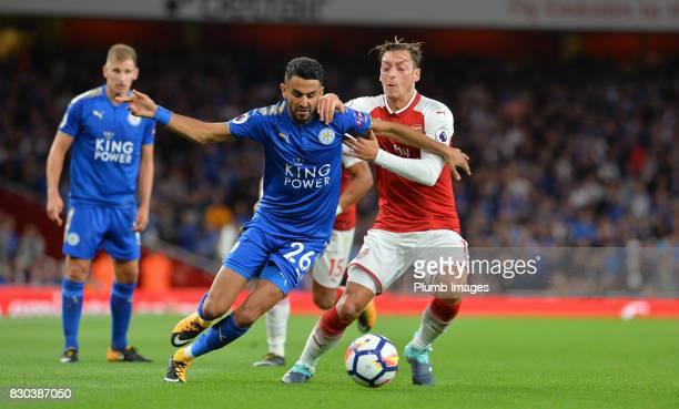 Riyad Mahrez of Leicester City in action with Mesut Ozil of Arsenal during the Premier League match between Arsenal and Leicester City at Emirates...