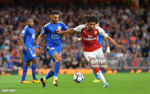 Riyad Mahrez of Leicester City in action with Mohamed Elneny of Arsenal during the Premier League match between Arsenal and Leicester City at...
