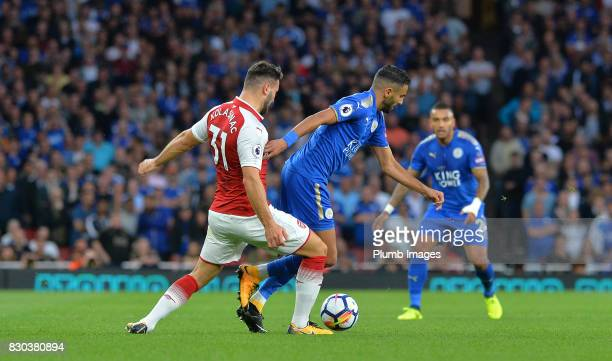 Riyad Mahrez of Leicester City in action with Sead Kolasinac of Arsenal during the Premier League match between Arsenal and Leicester City at...