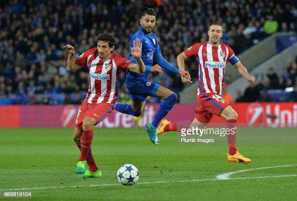 Riyad Mahrez of Leicester City in action with Stefan Savic of Atletico Madrid during the UEFA Champions League Quarter Final Second Leg match between...