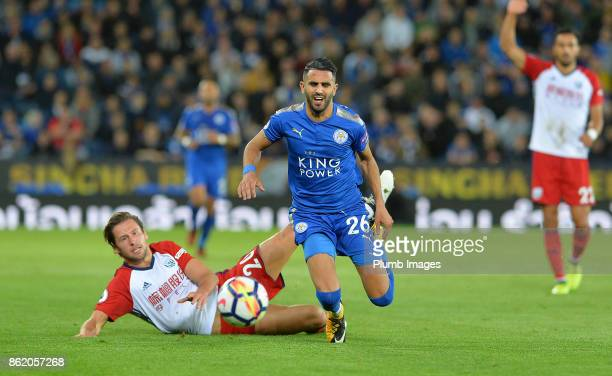 Riyad Mahrez of Leicester City is brought down by Grzegorz Krychowiak of West Bromwich Albion during the Premier League match between Leicester City...