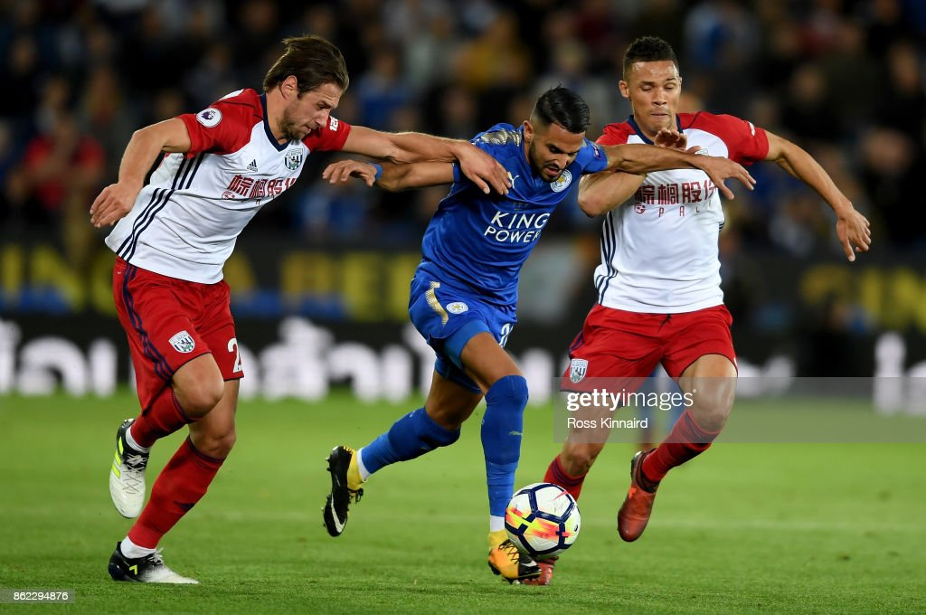 Riyad Mahrez of Leicester City is challanged by Grzegorz Krychowiak and Kieran Gibbs of West Bromwich Albion during the Premier League match between Leicester City and West Bromwich Albion at The King Power Stadium on October 16, 2017 in Leicester, England.