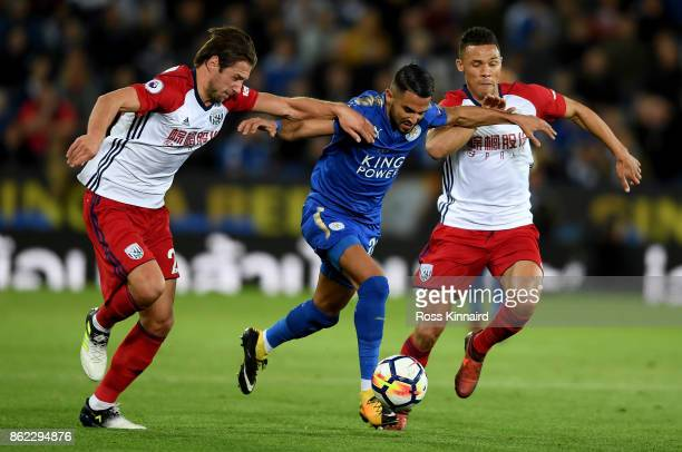 Riyad Mahrez of Leicester City is challanged by Grzegorz Krychowiak and Kieran Gibbs of West Bromwich Albion during the Premier League match between...
