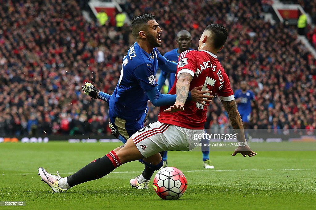 <a gi-track='captionPersonalityLinkClicked' href=/galleries/search?phrase=Riyad+Mahrez&family=editorial&specificpeople=9166027 ng-click='$event.stopPropagation()'>Riyad Mahrez</a> of Leicester City is challenged by <a gi-track='captionPersonalityLinkClicked' href=/galleries/search?phrase=Marcos+Rojo&family=editorial&specificpeople=6740047 ng-click='$event.stopPropagation()'>Marcos Rojo</a> of Manchester United during the Barclays Premier League match between Manchester United and Leicester City at Old Trafford on May 1, 2016 in Manchester, United Kingdom.