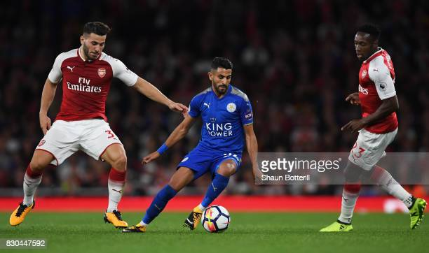 Riyad Mahrez of Leicester City is closed down by Sead Kolasinac and Danny Welbeck of Arsenal during the Premier League match between Arsenal and...