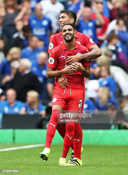 Riyad Mahrez of Leicester City is congratulated on his goal by Leonardo Ulloa of Leicester City during the Pre Seanon Friendly match between Cetlic...