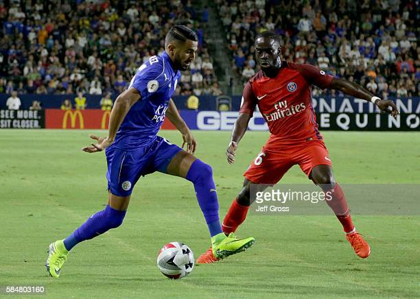 Riyad Mahrez of Leicester City is defended by Jonathan Ikone of Paris SaintGermain in the first half during the 2016 International Champions Cup at...