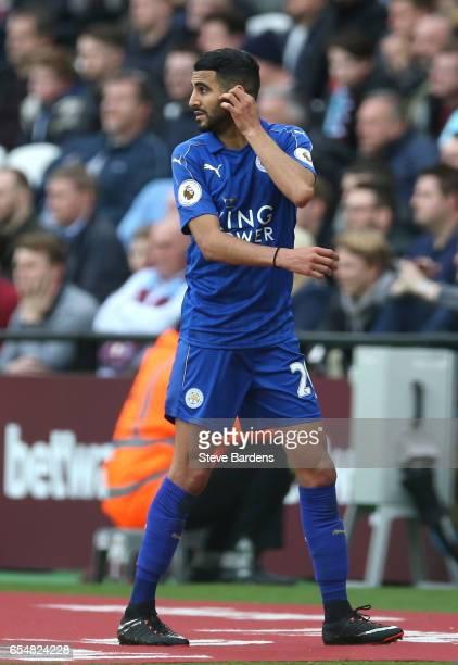 Riyad Mahrez of Leicester City is subbed off during the Premier League match between West Ham United and Leicester City at London Stadium on March 18...