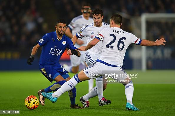 Riyad Mahrez of Leicester City is tackled by John Terry of Chelsea during the Barclays Premier League match between Leicester City and Chelsea at the...