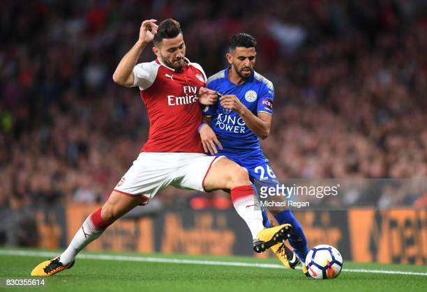 Riyad Mahrez of Leicester City is tackled by Sead Kolasinac of Arsenal during the Premier League match between Arsenal and Leicester City at the...