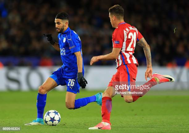 Riyad Mahrez of Leicester City is watched by José Gimenez of Atletico Madrid during the UEFA Champions League Quarter Final second leg match between...