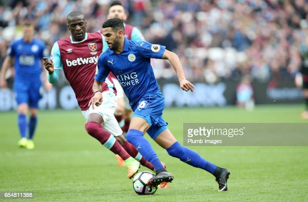 Riyad Mahrez of Leicester City runs with the ball during the Premier League match between West Ham and Leicester City at London Stadium on March 18...